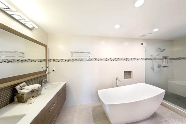 Contemporary expanded Master Bath with free standing tub and separate shower