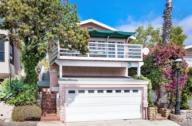 Classic Laguna Beach cottage located in the coveted oceanfront community of Victoria Beach