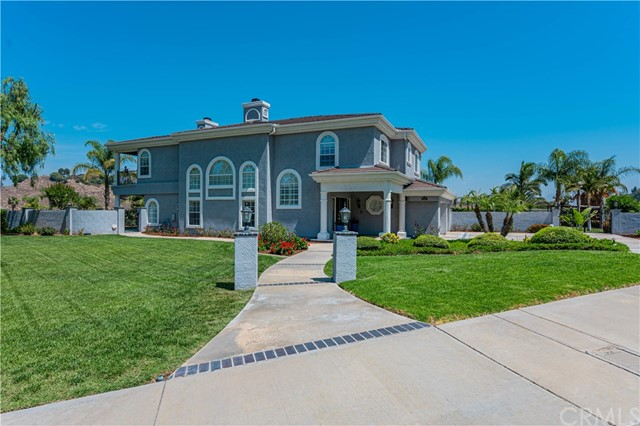 Nestled on a tranquil cul-de-sac featuring only 12 houses, awaits this stately, custom-built home sitting on just over ½ acre in the Hawarden Hills area. Pass through double doors to the entry & formal living room with impressive, vaulted ceilings. Spacious ground floor includes a formal dining room, wet bar with wine fridge, & family room with a 3D tv & fireplace. The exquisitely renovated gourmet kitchen presents granite countertops, walk-in pantry, & stainless steel appliances including a beverage fridge. A gorgeous custom staircase leads to the upstairs featuring a loft, all 4 bedrooms, & 3 baths including a jack & jill bath. The inviting master retreat features a sitting room, double-sided fireplace, & balcony boasting mountain, city lights, & sunset views. Generous master en suite has an oversized jetted tub, separate shower, dual sinks with vanity, & walk-in closet. Relax in the tropical, beautifully landscaped backyard including a newly plastered sparkling saltwater pool, waterfall, & jacuzzi. Garden offers ample space to plant your favorites, alongside existing fruit-bearing trees & bushes: orange, mandarin orange, apple, lemon, peach, grapefruit, guava, rhubarb, blueberry, & blackberry. You even have the option to raise your own chickens in the coop!  Additional highlights include plantation shutters throughout, all new interior doors, newer 7