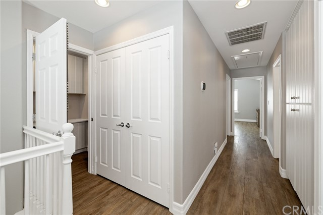 washer/dryer closet and enclosed office space at the top of the stairs