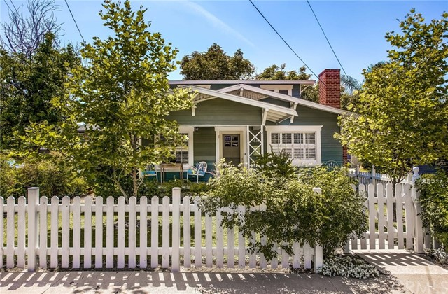 """Amazing opportunity for this 1920 3-Bed Historic Craftsman Front House w/Rear Studio in Old Towne! Located in the Historic Nutwood Tract just steps from W.O. Hart Park, this beautifully remodeled home is being sold by long time owners. The well-appointed front house has over $165,000 in upgrades in the past 3 yrs. The white picket fence & charming front porch welcome you! Inside, the front living & dining area with brick fireplace, features loads of natural light & refinished hardwood floors. The fully remodeled kitchen boasts white cabinets, quartz countertops & stainless steel appliances plus easy care """"wood"""" tile flooring. The main floor bedroom has access to the remodeled bath with designer tiled walk-in shower, granite topped vanity & tiled floors. A spacious laundry/utility room is conveniently located off the kitchen with full-sized stacked washer & dryer included in the sale plus stainless deep soaking sink & folding area. The 2nd floor offers 2 additional beds with neighborhood views plus a newer permitted 1/2 bath. Step outside to the raised rear deck & enjoy dining alfresco after tending to the garden. Or grab a book & curl up in the 12' vintage travel trailer that is also included with the sale. The detached rear studio of appx 420 sf with private entrance & yard offers a 3/4 bath, kitchen & it's own stackable washer/dryer. The extra long driveway can accommodate multiple cars with potential RV access & separate 30 amp service. New plumbing, electrical & HVAC too!"""