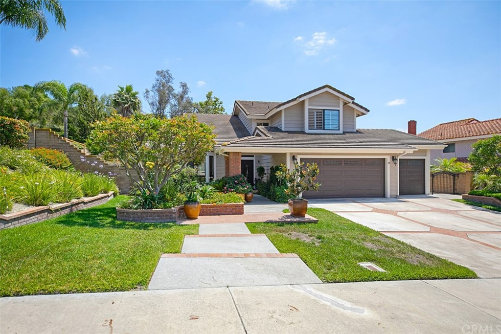 Nestled on a wonderful cul-de-sac street & just around the corner from Pittsford Park & LF Elementary school in the highly desirable neighborhood of San Rita Ridge is this beautifully appointed home that features a popular floor plan that is sure to delight the entire family.  As you enter the foyer you'll notice the handsome travertine flooring, the custom wrought iron staircase, the spacious formal living & dining rooms all graced with soaring ceilings & crown molding. Venture into the kitchen with gas cooktop, oven, microwave & dishwasher with views to the backyard! The kitchen opens to the kitchen nook & expansive family room with crown molding, gas fireplace, in ceiling speakers & provides direct access to the backyard! DOWNSTAIRS BEDROOM with slider to side yard, updated bathroom with a walk-in shower, 3-car garage, laundry room with storage are all part of the lower level. As you walk up the sweeping staircase, you are welcomed into the large master bedroom which offers high ceilings, multiple closets with built-ins, sunken tub, separate walk-in shower & dual vanities with granite counters & planation shutters. This is a wonderful & PRIVATE lot with a HUGE BACKYARD ideal for entertaining or a building a custom pool. Mature landscaping, trees, colorful blooms & a gazebo with ceiling fan. Fabulous schools are so close by, as is the Lake Forest Sports Park, trials, mountain biking & easy access to freeways.  Low HOA and no Mello Roos.  A 10-YEAR ROOF CERT WILL BE OFFERED.