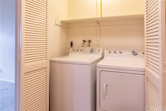 Washer Dryer closet includes wsher & dryer
