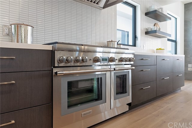 Premium appliances, custom cabinetry and modern open shelves