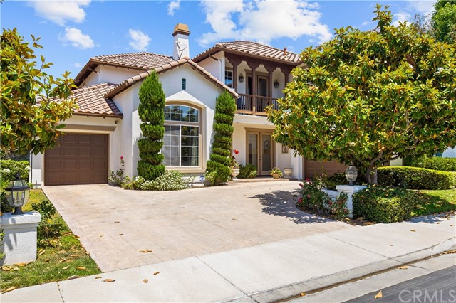 THIS GORGEOUS HOME IS LOCATED ON A LOVELY, CUL-DE-SAC STREET IN THE DESIRABLE, 24 HR GUARD-GATED COMMUNITY OF 'MADRID' IN TUSTIN RANCH, ACROSS FROM TUSTIN RANCH GOLF COURSE. THIS HOME OFFERS 4 BEDROOMS, +OFFICE, +BONUS RM, 4 BATHS & APPROXIMATELY 3,700 SQUARE FEET OF LUXURY LIVING.  THE UPSTAIRS KIDS WING FEATURES A TEEN ROOM/BONUS ROOM/MOVIE ROOM AND THE  MAIN FLOOR FEATURES A SPACIOUS OFFICE WHICH COULD BE CONVERTED TO A MAIN FLOOR 5th BEDROOM. THE KITCHEN OFFERS A HUGE GRANITE ISLAND, WHITE CABINETRY, STAINLESS STEEL APPLICANCES, BUILT IN REFRIGERATOR, LOTS OF STORAGE, A LOVELY BREAKFAST NICHE & WALK-IN PANTRY. THE CHARMING DINING ROOM & LIVING ROOM ARE ADJACENT TO ONE ANOTHER & ARE WONDERFUL ENTERTAINING SPACES.  THE KIDS ROOMS UTILIZE A JACK N JILL BATH BETWEEN THEM PLUS A SEPARATE HALL BATH. THE LUXURIOUS MASTER BEDROOM SUITE IS ACCENTED WITH A COZY FIREPLACE & HUGE WALK-IN CLOSET. THE MASTER BATH HAS UPGRADED PORCELAIN TILE W/TRAVERTINE ACCENTS & FEATURES A SEPARATE SOAKING TUB & WALK-IN SHOWER. THE SPARKLING PRIVATE POOL & SPA ARE PERFECT FOR FAMILY FUN!! ENJOY COOKING FOR YOUR GUESTS IN THE OUTDOOR COVERED KITCHEN WITH TRAVERTINE COUNTERS & A BUILT IN BBQ.  YOU'LL FIND PLENTY OF PARKING & STORAGE IN THE SPACIOUS 4 CAR GARAGE (THE SINGLE DOOR GARAGE IS A TANDEM). AWARD WINNING SCHOOLS!  WALKING DISTANCE TO LADERA ELEMENTARY & PIONEER MIDDLE SCHOOLS.  THIS GUARD GATED ENCLAVE OF HOMES IS DIRECTLY ACROSS FROM THE TUSTIN RANCH GOLF COURSE. THE TUSTIN RANCH GOLF COURSE HAS HOLIDAY BRUNCHES, SUMMER CONCERTS/BBQ & TACO TUESDAY!! JUST MINUTES TO TUSTIN MARKETPLACE FOR SHOPPING, DINING & THEATERS.