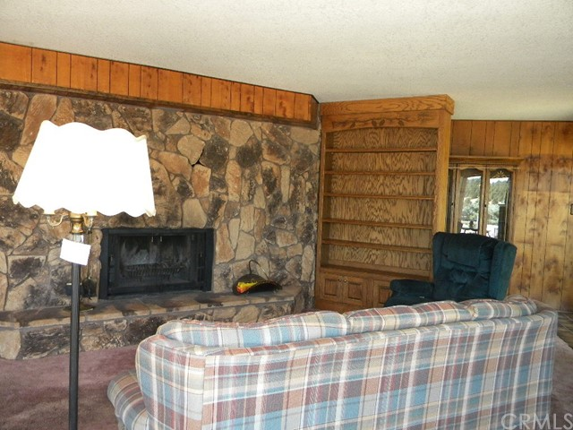 Wood burning fireplace with built-ins.