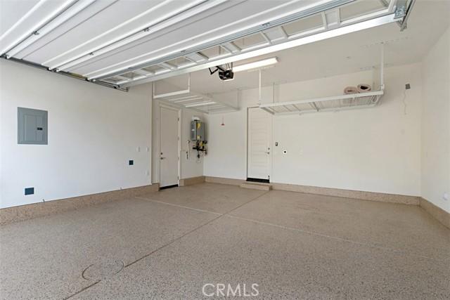 Garage with garage racks and Tesla Nema charging outlet