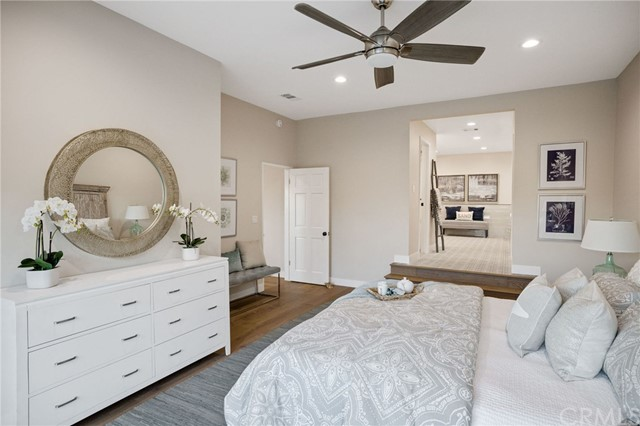 lower level master suite bedroom with ensuite bath