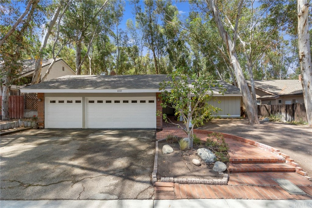 Great three bedroom, two bath one story home in The Woods. Lite and bright with vaulted ceilings and new interior paint. Hardwood flooring thruout. Both bathrooms have been upgraded. Large family room with floor to ceiling gas or wood burning brick fireplace. Three car garage. Wake up every morning feeling like you are in Big Bear/Lake Arrowhead. Take a short walk to the Lake Forest Beach and Tennis Club offering swimming pools, tennis, clubhouse and lake access. Walking distance to all schools. Home is NOT located directly on Jeronimo Rd. but on a frontage road off the main street. Does not back to the street.