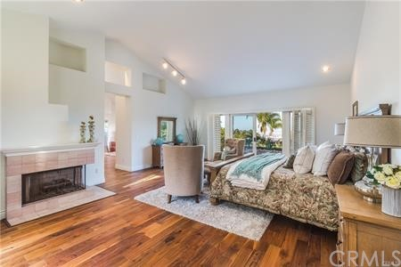 Master bedroom is over 950sf featuring fireplace, vaulted ceilings, sliding doors to courtyard.