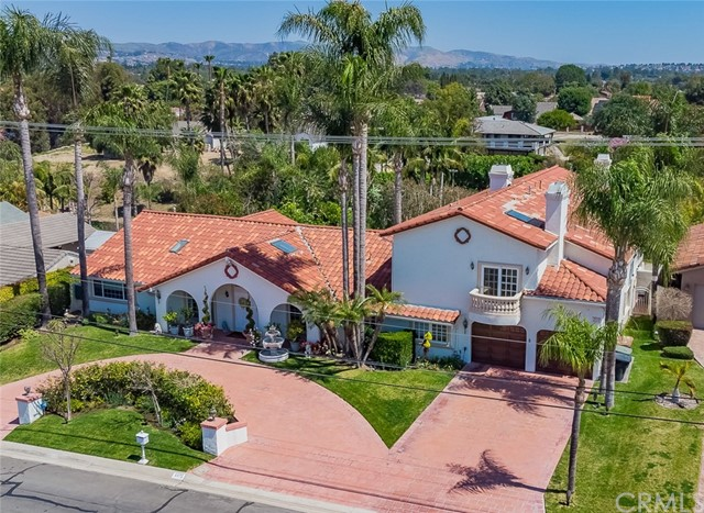 You'll want to stay forever at this beautiful, peaceful, luxury paradise. Built upon a fabulously landscaped, nearly 1 acre lot, this custom home has a natural rock pool, spa and koi pond, all with waterfalls. From the backyard patio a winding path leads through a grass lawn, past magnificent palms and colorful trees and plants to a raised gazebo. Continue to the lighted, regulation tennis court, three rose gardens, many fruit trees and a custom-built shed. This palatial home has two (2) master bedrooms, one on each floor. First floor: granite-countered kitchen with island, formal living room, formal dining room, family room with separate dining area and wet bar, and two (2) offices. In addition to two guest bedrooms, there's a laundry room and a 105-bottle wine cooler. The fourth downstairs bedroom is currently a mirrored dance room (perfect as a gym too), with full bathroom and sauna. Second floor: stunning, oversized master bedroom with balcony, a spacious master bath, an incredible walk-in closet, and a bonus room (currently a music room with walk-in closet, could be a bedroom, not included in square footage). Skylights and ceiling fans throughout. Marble flooring is complemented by newer hardwood floors and carpeting. Three fireplaces. Four-car garage. Outdoor 3/4 bath. Water heaters and all three HVAC units are newer. There is also a security camera system, plus a recently-installed whole-house backup power generator.