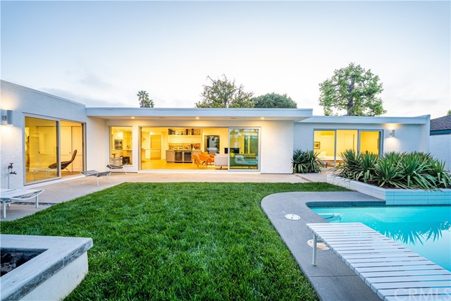 1506 Anita is the epitome of Mid-Century Modern Living right in the heart of Newport Beach.  This 2800 sqft home boasts 4 bedrooms all with en suite bathrooms.  As you enter the large double doors you are immersed in the lush greenery of a Pistache Tree wrapped in a Stagehorn Fern.  Walls of glass surround this courtyard and its beauty is admired from many different angles inside the residence.  This home went through a complete renovation in 2017 and has been meticulously maintained.  An open concept floor plan allow for the perfect California indoor/outdoor lifestyle.  Walls of glass on both sides of the living room, one equipped with La Cantina sliding doors open up to your resort style backyard.  Pool, seating area, and a built in fire pit, are just some of the features of this one of a kind home.  Other features include: French Oak Flooring throughout the home, Thermador appliances, Tesla Charger in the garage, Epoxy Garage floors, quartz countertops, dual tankless water heaters, dual AC units, and paid solar. Located near world class beachs, shopping, and dining, you won't want to miss this property.