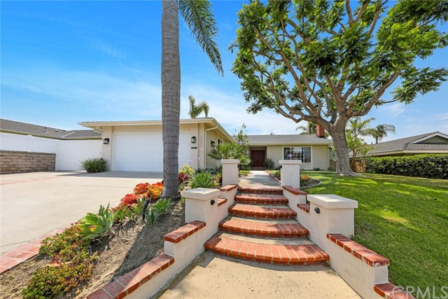 This gorgeous single level, 4 bedroom home in the highly sought after Niguel Hills neighborhood in Laguna Niguel is now available! As you approach the double front door entry, a lovely Jacaranda tree stands as a focal point in this welcoming front yard. Upon entry, the large living room greets you with a cozy fireplace and natural light that streams through a large picture window and even offers views of Saddleback and the stunning mountains in the distance. The kitchen opens to the eating area and family room and includes a breakfast bar, garden window, and French doors which lead to the backyard. Great for gatherings! The sunny yard features a large grassy area, built in barbecue entertaining area, large patio with automatic retractable awning, and planting beds perfect for starting a garden! The private main bedroom suite includes a high pitched ceiling, French doors, and an upgraded bathroom with large relaxing soaking tub and separate walk in shower. 3 additional bedrooms, a bathroom, and utility room/office with direct access to the garage complete this well planned home. This home includes air conditioning and has been re-piped with PEX. Additional gated parking for RV, boat, or additional vehicles.