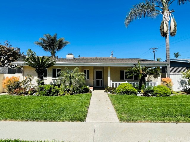 """This is the single story home 1.5 miles away from the Downtown area in """"Surf City"""" Huntington Beach that you have been waiting for! This home boasts 3 bedrooms, 2 baths, and comes semi-furnished.  As you arrive, you'll notice the very well manicured lawn and plants that give this home a beautiful curb appeal.  The interior of the home is an open layout concept with tons of space and naturally bright from the skylights. The entire home features tile flooring for ease of maintenance and care. The bathrooms have been redone with custom tile work and vanities.  The galley kitchen includes tiled counters with newer appliances, and access to the laundry room.  The backyard features a concrete area and a grassy area perfect for entertaining. The two car detached garage can be accessed from the alley. Extras include Air conditioning, a refrigerator, washer and dryer, couches, chairs, coffee table, new bed mattresses including new sheets, dressers, lamps, flat screen TVs, and even kitchenware.  Do not miss this opportunity!"""