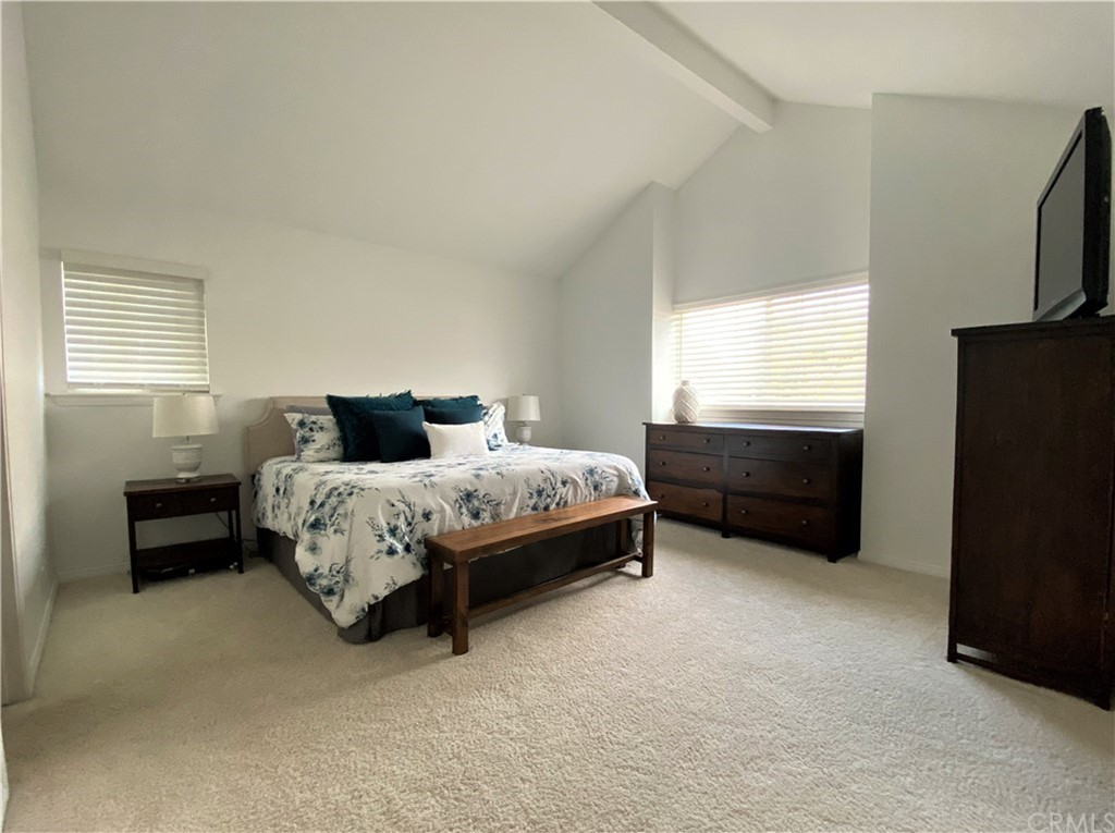 Owners bedroom suite with vaulted ceilings and walk-in closet