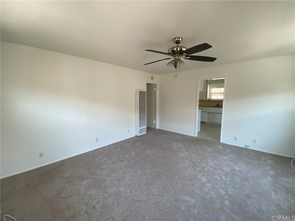 This living room is a vacant unit on the left that shows the floor plan of the units for sale. The units for sale are the mirror image of this unit.