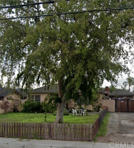 An Investors/Developers Dream! Come see this incredible 2 bedroom 1 bath home in situated in the desirable city of Anaheim. The home sits on 18,280 sq ft lot prefect for an investor/developer who would like to develop the land. The front yard is fenced with a beautiful tree shading and has a long drive way leading the garage. The washer/dryer hook ups are located next to the kitchen leading out to the back yard. Its in need of TLC. The Seller is selling as-is and no repairs will be done. You can only develop a single family home w/possibility of a possible back house but you would need to confirm with the city of Anaheim. Seller will not carry loan.