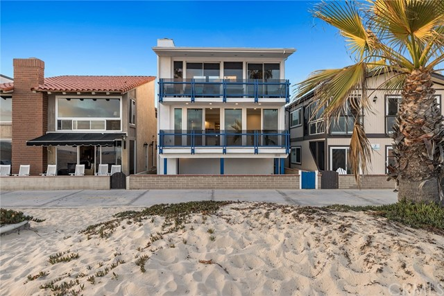 Step up to the oceanfront lifestyle! Superbly positioned between the Balboa and Newport piers and just a short stroll from bustling Marina Park and myriad water activities, this freshly remodeled three bedroom, two bath, separately deeded, R-2 condo affords a unique turn-key opportunity to live waterfront in Newport Beach. Enjoy easy, breezy single-level living with direct elevator access, and an open lay out that revels in whitewater views and sunsets behind Catalina. Floor-to-ceiling glass opens to a seaside terrace perfect for soaking up the sun and enjoying the activity of the beach front below. Open format living, dining and kitchen areas play to relaxed days spent at the beach with family and friends. A newly remodeled kitchen boasts abundant storage and prep space, top-line appliances, and separate butler's pantry with wine refrigeration to make entertaining a breeze. An adjacent patio is perfect for cozy outdoor dining and BBQ fun. With three generously proportioned guest rooms, the master suite is highlighted by a spa bath with dual vanities, shower and soaking tub. A separate laundry room also allows for additional storage. Truly a one-of-a-kind opportunity on the oceanfront promenade, this condo is one of only two units in the three-story building. Each owner enjoys 3 car garage parking, a large storage area, beach bath, and access to a common beach front patio. Grab your beach bag and head to the sand...this coastal condo checks all of the boxes!  VIRTUALLY STAGED