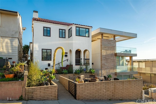 RARE opportunity to own TWO OCEAN VIEW HOMES ON A WALK STREET in downtown Manhattan Beach ONLY A BLOCK FROM THE BEACH! Updated 4 bed/3 bath 1920s Spanish on the walk street side & more recently remodeled 3 bed/3 bath South-Facing Mid-Century Modern on the alley side…both with 2-car tandem garages that offer an easy direct approach through the city parking lot. Perfect for the Buyer who wants to live in one & rent the other…or the buyer with extended family…or the buyer who needs a vacation home compound with privacy!!! Leave your car in the garage because this property is a SHORT WALK TO EVERYTHING! CURRENTLY VACANT FOR TOTAL FLEXIBILITY! Pro forma rents are $15k total ($9k Front House & $6k Back House).