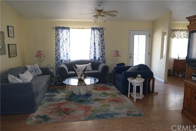 Cozy living room with viewing of TV in Entertainment Center.  Lots of room for guests.