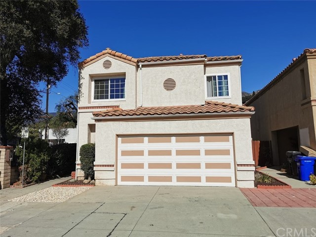 LOCATION IS KEY!!  This beautiful 4 bedroom, 3 bathroom home is located in a small gated planned unit development just adjacent to Royal Oaks Walking & Biking Trails and just minutes from Fish Canyon.  The home features cathedral ceilings with an open floor plan, updated kitchen, remodeled bathrooms, hardwood floors throughout, cozy fireplace with dual location in the family room & dining room has sliding ranch style doors that lead out to the courtyard which is perfect for entertaining & bbqing.  There is one bedroom with connected bathroom located on the first level which is perfect for guest.  Large master suite with vaulted ceilings, dual sinks, bath tub and walk-in tub and walk in closet.  Direct access 2 car garage.  The community features a security door to enter the complex.  This home is located just minutes from the California School of Arts San Gabriel Valley, lots of shopping centers, restaurants, mountain trails & close to the 210 & 605 fwy.