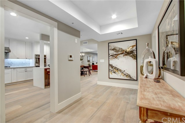 Priced at 2019 price, see unit #105 2 years ago!! Enter this stunning home with a beautiful entryway leading to a new open floorplan. The breathtaking chefs kitchen is a pleaser to the eyes as well as a delight to the home chef. Enjoy the new white shaker soft close cabinets and quartz countertops, new gorgeous backsplash, new appliances including a built in double oven, and a great entertainers island with wine frig and microwave. The home is set off by all new recessed lighting throughout the entire unit, new flooring, and new carpet in the bedrooms. The master bath is to die for with a lovely free standing tub, and an amazingly stunning shower with designer tile work that will make you happy. The other bathroom is just as elegant with new cabinetry and matching countertops and backsplash. The unit backs up to a lovely wooded area to make it a joy to relax on your patio in privacy. Additional amenities include, lit mirrors in all 3 bathrooms, wine cooler master, all new shaker doors, new water and shower faucets, and new paint. Brentwood living at it's finest