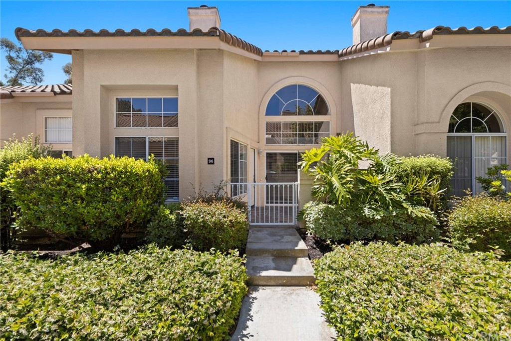 Welcome Home! A must see! Beautiful 1360sqft 2 bedroom plus loft home. Enter into your own privately gated slate stone patio courtyard.Open the front door to light and bright open floorplan with volume ceilings and plenty of windows. Spacious family room with cozy fireplace opens to large dining room with breakfast bar and sliding glass door to front patio.Spacious kitchen with white cabinetry, stainless pulls and plenty of counter space.Upstairs leads to large loft. Large secondary bedroom with volume ceiling. Oversized master bedroom with volume ceiling, master bathroom with dual vanities, tub and shower with enclosure and large walk-in closet. Inside laundry, oversized 2 car garage with epoxy floor and workbench. Only 5 miles to world famous Laguna Beach! Close nproximity to community pool and Tot Lot! Easy access to toll road, freeway and entertainment.