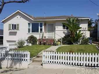 Bright & Beautiful completely remodeled 3 bdrm 2 bath (2 BDRM + OFFICE) home in El Segundo!   New Kitchen, New Baths, New Paint - It's Beautiful!   This home is perched up on the street with white picket fence, roses and OCEAN peek views.  Located in a cul de sac, 2 blocks from the beach.  Large front windows and hardwood floors create a welcome relaxed beach feel as  you enter.  Living room opens up to a completely remodeled kitchen with all new stainless steel appliances, plenty of cupboard space (some glass), &  a spacious kitchen island with bar stools.  Great entertaining space!  The dining area sits just off the kitchen w/tall windows  & skylights looking into the sky, garden patio and back deck/backyard.  Have breakfast on the deck in the morning?  ** Yes! ... with a bit of an ocean peek too!! **  Terrific backyard with grass and garden and plenty of room for entertaining.  Master bedroom includes private bath access and plenty of closet space, hardwood floors, and privacy.  The second bedroom is spacious and light towards the front of the home, and the third bedroom can be used as an office or bedroom.  Hardwood floors run throughout the entire home.  Both baths are exceptional in design and upgrade.  Quartz counters, huge glass door shower, and plenty of counter space. Parking for 2 or 3 cars in the driveway. The Perfect  Peaceful home in a quaint El Segundo neighborhood.  Walking to schools, parks, shopping, & Beach!  LAX/405 & 105 Freeway in 5 minutes.