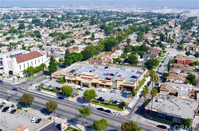 Realty Group Advisors is pleased to present 3111 E Florence Avenue for sale in Huntington Park, California. This freestanding, single-tenant, ±28,000-square-foot retail building sits on a ±1.4-acre lot and is fully leased to Smart & Final, one of the longest operating food retailers in the United States. The property features excellent visibility at the signalized intersection of Florence Avenue and Mission Place, with a combined average daily traffic count of more than 33,000 vehicles. 3111 E Florence Avenue is easily accessible to consumers via I-710 to the east, I-110 to the west, I-105 to the south, and I-10 and I-5 to the north. Additionally, a bus stop along a 38-stop bus route is located directly in front of the building, and Dial-A-Ride taxi services are readily available. This accessibility allows the property to reach the strong surrounding demographics in the Huntington Park area, which is one of the most densely populated markets in Southern California. Within a five-mile radius of the building live more than 1 million residents, who contribute to a consumer spending total of over $7.2 billion. Located just seven miles south of Downtown Los Angeles, the property is situated along a well-established urban street retail district. It draws from the popular surrounding communities of Lynwood, Bell, and Maywood. With its ease of access and strong surrounding demographics, 3111 E Florence Avenue offers an excellent e-commerce-proof investment opportunity in the Gateway Cities district of southeastern Los Angeles County.