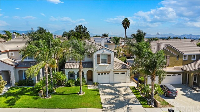 """First time on the market in 20 years, this beautiful executive home with over $125,000 in upgrades, located in Rancho Cucamonga, recognized as an """"All-America City"""" by the National Civic League in August 2020. Features include: Open formal living/dining room, large kitchen with island that opens to an oversized family/great room with lots of natural light, downstairs bedroom (optional 2nd masters suite), full bathroom downstairs & inside laundry room, porcelain wood look tile throughout the downstairs, blinds on all windows.  Upstairs features: Master suite with retreat ideal for sitting area; gym or optional 5th bedroom, ensuite bathroom with quartz countertops, travertine tile soaking tub surround, separate tiled shower & generous walk-in closet, 2 additional spacious bedrooms, hall bathroom with separate dual vanity in dressing area, tiled shower/tub, generous open bonus room (can be a possible game/play room or additional bedroom), waterproof vinyl wood flooring throughout the upstairs. Fully landscaped front & rear yards, covered patio in backyard, 2 car finished garage, poured concrete to both sides of home & wood fence surrounding back & side yards with a wrought iron gate that offers security for your children &/or pets to play safely. Remodel/Upgrades began end of 2019 and completed 1st quarter of 2020.  Easy access to schools, churches, shopping & freeways, this home has so much more to offer anyone looking to live in the heart of the city."""