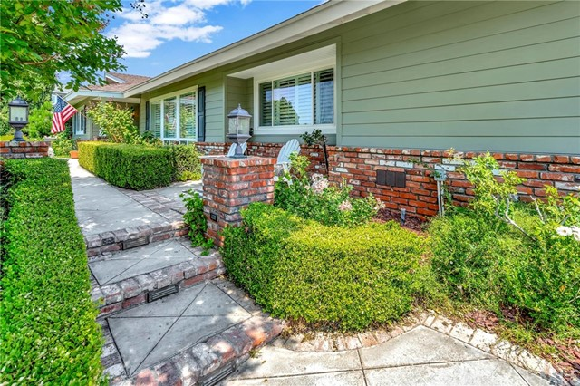 Sprawling Ranch-style home on a spacious, secluded lot, set up above the street in the desirable Raymond Hills neighborhood. Completely updated and tastefully remodeled, this home has an ambiance that you want to experience. Four good-sized bedrooms plus an Office. The Kitchen was remodeled with granite counter tops, stainless steel appliances, double oven, Beautiful cabinetry, a Breakfast nook, and a bay window looking out at the large backyard. There is a Butler's Pantry off of the Kitchen as well as a Guest Bathroom tucked around the corner. The Family Room, adjacent to the Kitchen, has a Board and Batten Wall, Farmhouse chandelier and a slider leading out back to the covered patio. There are hardwood floors throughout, plantation shutters, a wood burning fireplace, and LED recessed lighting. Both of the larger bathrooms were remodeled with marble tile and high quality glass enclosures. The Master Suite has a dressing area with mirrored closets beside the en suite bath. Outside in the backyard, you will notice that neighbors are hard to see. It is an incredibly private yard with a Pool, Spa, Large lawn beyond the white picket fence, as well as a partial basketball area. The garage has an additional workshop attached beside it, where the laundry is located. In August of last year the pool and spa were re-plastered and re-tiled, as well as new coping, a new heater, filter and pump. Furnace was just replaced mid-2017. Water heater was just replaced in 2020. So much love has been poured into this home that is situated in the highly desirable, Troy High School neighborhood. The home is approximately 2 miles to Downtown Fullerton and 4 miles to Downtown Brea. Easy Freeway Access to either the 57 freeway or the 91 freeway.