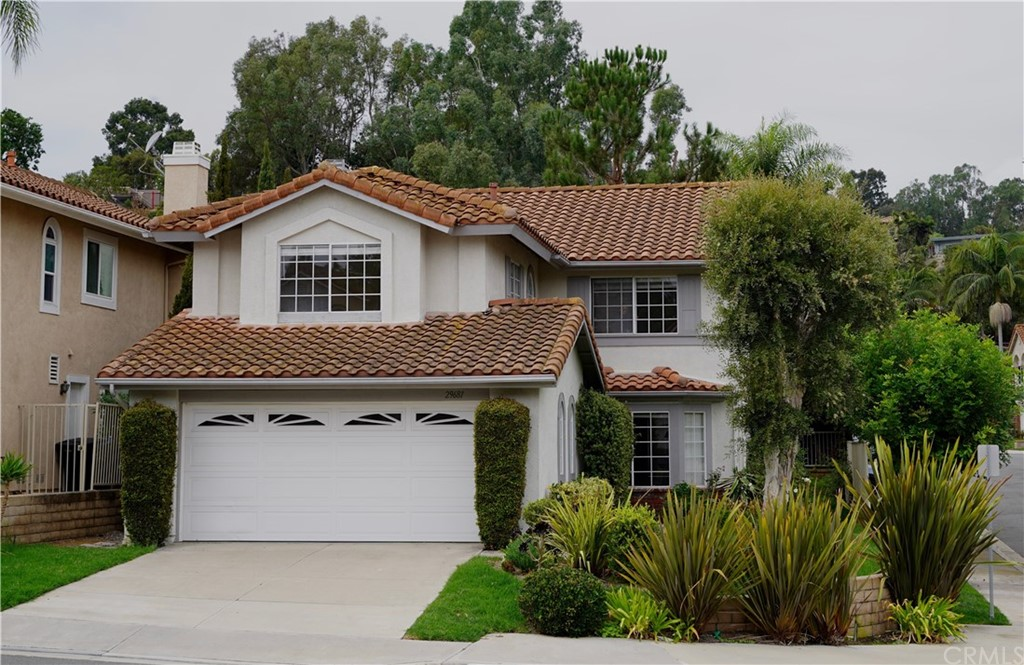 Beautiful Laguna Crest Home in a quiet neighborhood.  Wonderful curb appeal, freshly painted, double door entry with spacious living room and formal dining room.  Family room with fireplace & wet bar.  Large master suite upstairs with small walk in closet and wall closet.  All bedroom closets have closet organizers.  Secondary bedrooms are well sized with hall bath.  Kitchen includes a breakfast nook overlooking the back yard, gas cooktop and double ovens.  Private backyard for entertaining with small lawn area.  Close to schools, several markets, restaurants, and beaches.