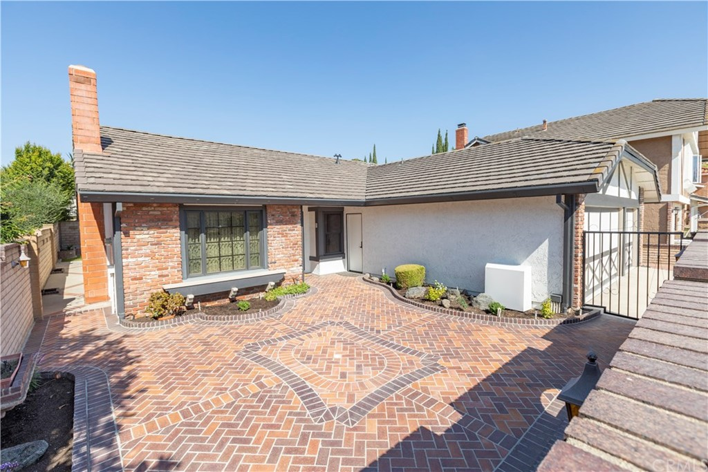 If you appreciate a highly upgraded and beautifully maintained home, this is the one for you.  This lovely 3 bedroom, 2 bath, 3 car garage, small cul de sac, Serrano Park home has been meticulously maintained and upgraded by the original owner.  The kitchen and bathrooms are updated and upgraded with beautiful maple cabinets, soft close drawers and doors, plus custom lighting and granite counters.  Beautiful tile flooring flows through the entry, living room, dining room, kitchen, and family room.   There is crown molding everywhere including the closets, and upgraded baseboards and chair molding throughout plus custom window coverings. A beautiful new front door greets you and there are solid core interior doors in each room. The custom fireplace features LED lighting effects.  The delightful enclosed courtyard features endicott pavers,  brick planters with new flowers, plants, and planter mix plus wall lanterns.  The backyard features a large lattice patio cover, brick planers with accent lights, and a small easy care lawn area.  New copper plumbing throughout, new heating and A/C system, attic and house exhaust fans, new tankless water heater, built in storage cabinets and acoustical ceiling and light in garage.  For the golfer there is a motorized golf driving net in the garage.  The roof has been reconditioned and has rain gutters and down spouts, plus reinforced storage space in attic above garage.  HOA pools, parks, tennis, clubhouse, tennis, parks, and greenbelts.