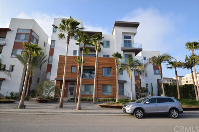 """Location, Location, Location. This flat occupy the entire third floor. Highly upgraded single level condo in Silicon Beach's premiere community of Playa Vista. Prime corner location facing south. 3 BRs,2 1/2 BAs, plus library. Two large terraces with floor to ceiling accordion doors that open completely for indoor/outdoor living and overlook the world famous Spruce Goose Hangar (home of Google). View of """"The Spot"""" greenbelt, water fountain and The Bluffs. Enormous great room features light color wood floor. Entertainer's kitchen with luxury """"Bosch"""" stainless steel appliance package, custom cabinets, custom stone counter top with full backsplash. Large master suite with free standing tub and custom marble shower surrounding. This home is filled with floor to ceiling windows and natural light. LEED Platinum certified with energy saving features like solar panels, tankless water heater, LED lighting, etc. Walking distance to everywhere Playa Vista has to offer. Runway mall, Whole food market, CVS, Cinemark movie theater, two club houses, numerous parks and schools, too much to mention. Must see to appreciate."""