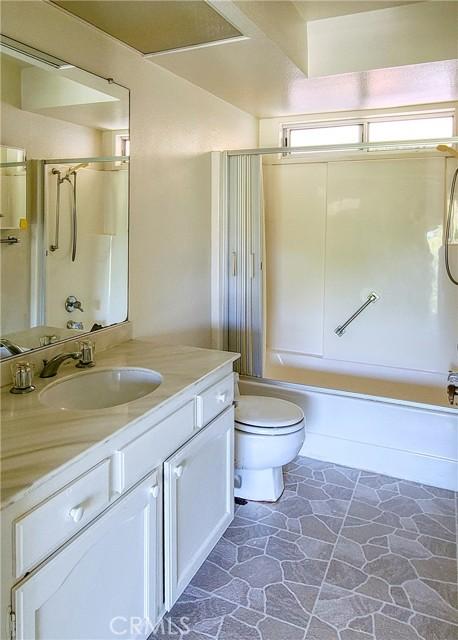 Master bath has window.