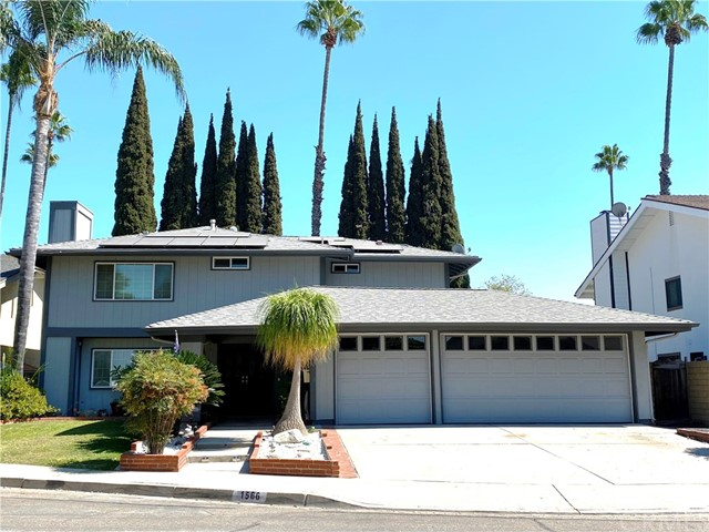 Welcome to 1566 Perry Drive in one of Placentia's quiet cul-de-sac neighborhoods bordered with towering trees and beautiful scenery. This four bedroom, 2 1/2 bathroom, 2,158  sq.ft. home sits on a generous 6,175 sqft lot.  The three car garage has one bay with an additional rear door.  The driveway accommodates three additional cars. Enter the home through double doors where a custom tiled entryway welcomes you. Read your favorite book in the formal living room near the fireplace or enjoy your favorite show in the comfortable family room complete with a dry bar for your favorite cocktail .  The dining area sits just outside the kitchen and near a sliding glass doorsmaking it easy to enjoy food from a barbecue.  The kitchen is a perfect place to explore your culinary prowess.  You'll love the soft close doors, tons of cabinet space and well thought out layout for the chef of the house.  As you ascend the stairwell with high ceilings, 4 bedrooms offer an  opportunity to retreat for the day.  The master bathroom has been upgraded and offers an oversized shower with upgraded hardware and remodeled vanity. Residents enjoy top-rated schools, close proximity to freeways, shopping and restaurants.