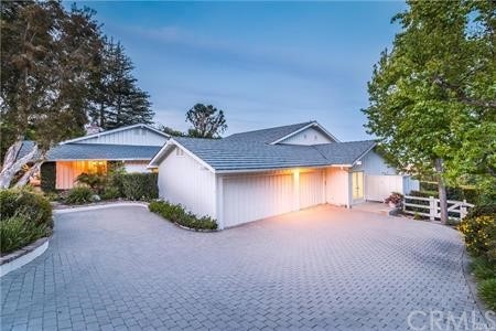 Aerial view of property, side access to back area. Well maintained landscaping throughout.