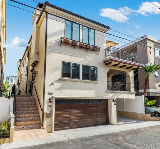 """WALK TO EVERYTHING!  Located in the heart of Manhattan Beach's charming GASLIGHT DISTRICT, this townhouse is not to be missed!  QUALITY-BUILT in 2006 by master builder, Ken Johnson on an OVER-SIZED, prime lot, this 3 bedroom + 3.5 Bath 2345 sq. ft. townhome features a recent TOTAL CUSTOM REMODEL of the MASTER BATH, an open plan chef's kitchen with tons of cabinet space, top of the line appliances (a 48"""" stainless steel refrigerator & separate wine refrigerator), a SPACIOUS living room with built-in bookshelves and fireplace, lovely, refinished Brazilian cherry WOOD FLOORS, 2 DECKS, A/C, a beautiful MASTER SUITE with walk-in closet and a large, IMMACULATE GARAGE with 2 easy access outside parking spaces. The home is also light and bright with multiple skylights and custom shades.  Walk to THE BEACH, the MANHATTAN PIER, the downtown restaurants and Grandview Elementary School."""
