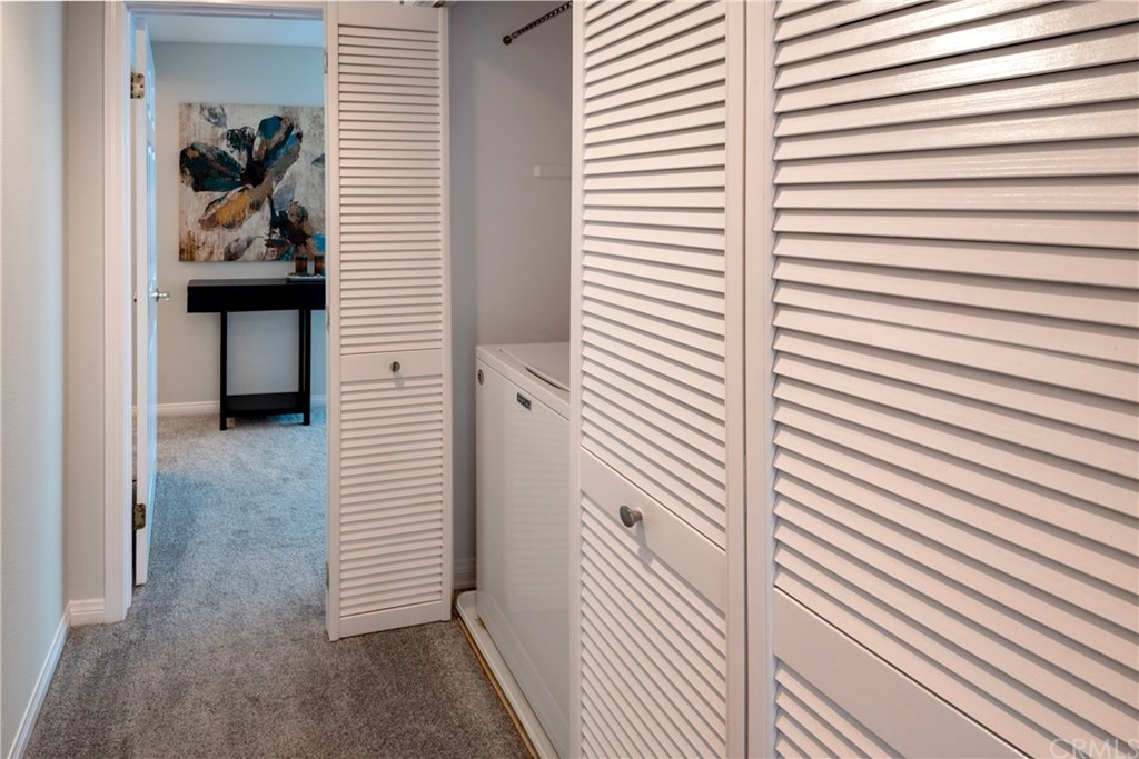 The Hallway is Attractively Lined with Folding Shutter Doors