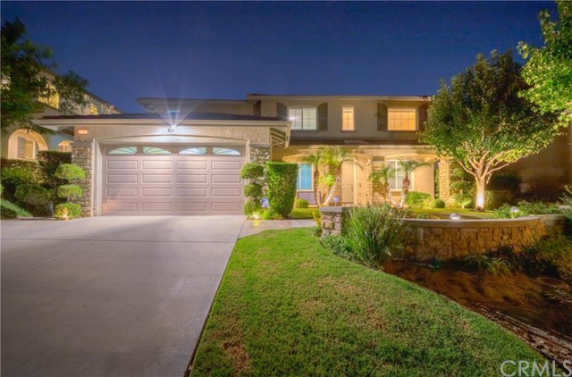 Spectacular luxury living in the prestigious city of Chino Hills. Elegantly Remodeled Home with Gorgeous Views, Custom landscaping & slate walk way with beautiful curb appeal. Offering 5 bed + huge loft + 3 bath layout! Convenient main floor 1 bed / 1 bath! Formal entry with towering ceiling emphasizing the large living & dining room w/custom drapes included. Beautifully remodeled kitchen with granite counter top/back-splash, maple cabinets, built in gas range/hood, kitchen island, breakfast bar, plus, window to enjoy the breathtaking views! Kitchen opens to another casual dining space & generous family room with fireplace & built-in entertainment center. Family room w/glass french door to the Stunning Entertainers Paradise, $75K in upgrades! Custom hardscape, Gas fire pit, LED lights throughout, built in BBQ w/side burner, sink & abundant seating area to host all your family & friends while taking in the Breathtaking Views! Second level provides master suite w/en-suite bath; his/hers sinks & walk in closets, soaking tub & shower. Huge bonus loft currently set up as convenient office space. All remaining bedrooms are abundantly sized & share an over-sized hallway bath w/dual sink & shower in tub. In addition, convenient laundry room, over-sized driveway leads to 3 car tandem attached garage & much more!! Home boasts Pride of Ownership! Centrally located near parks, schools, shopping, dining, entertainment & easy freeway commute! Don't miss this once in a lifetime opportunity!