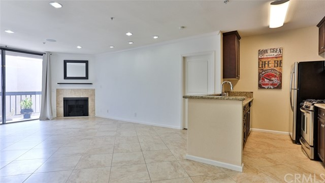 This spacious 2 bed-2 bath is in the upscale Hollywood Regis community. Amenities include a resort-style pool and spa, high end fitness center, fireplace, and assigned parking with a gated 2-car garage (tandem). For this unit, location is key. You will be walking distance to attractions such as the Hollywood Walk of Fame, Dolby Theater, Hollywood Bowl and the beautiful 130-acre Runyon Canyon park, with extensive biking and hiking trails.  At the same time, you will have easy accessibility to the metro rail lines, and the 101-freeway entrance. The unit features 2 large bedrooms separated by a spacious tile living and dining room. It has luxurious bathrooms with granite countertops, and a fully equipped granite countertop kitchen which includes stainless steel appliances, and a dishwasher. It also includes LG state of the art combination washer-dryer. The Master suite features a walk-in closet.  You will also have your own private balcony, overlooking the pool. The building has controlled access entry with a nighttime security guard and covered and gated parking with EV Charging. The HOA fee includes a 6x6 storage area in the garage.