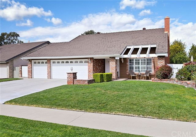 Warm and Welcoming 4 Bedroom / 3 Bath Home located in one of the Best Neighborhoods in Placentia! The Double Door Entry Opens to the Formal Living Room w/ Cozy Brick Fireplace, Built in Cabinets, & Spacious Dining Room. The home features Dual Pane Windows & Wood Shutters throughout. The Remodeled Kitchen has a Large Breakfast Bar that seats 4, Quartz Countertops, & Custom Maple Cabinets with pull-out drawers for organizing.  Remodeled downstairs powder room has a pedestal sink & wainscoting. Gorgeous Wood Flooring Downstairs & Wrought Iron Stair Railings lead to the 4 Spacious Bedrooms upstairs. The Master Bedroom has a walk in closet & a 2nd closet w/ built in organizers. Hallway Bathroom  remodeled with a granite topped vanity.  The backyard is the perfect place for entertaining family & friends! It features a Private Pool & covered patio with Gorgeous stamped concrete hardscaping. There's a nice sized landscaped grassy yard w/ lemon & orange trees.  The Three Car Garage features an additional  workshop area that was added on for even more space!  This home has STORAGE - There's upper platform in the garage as well as even more attic storage  accessed from an upstairs bedrooms. The home has a new water heater & newer ducting. This wonderful home is located very close to great restaurants, shopping, parks,  & is freeway close.   It sits in the Award Winning Placentia Yorba Linda School District.  Welcome Home! Virtual Floor Plan- http://www.valmls.virtualfloorplan.link