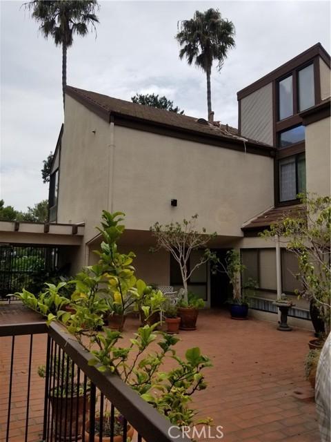 View of Front door entrance, patio, courtyard and condo.