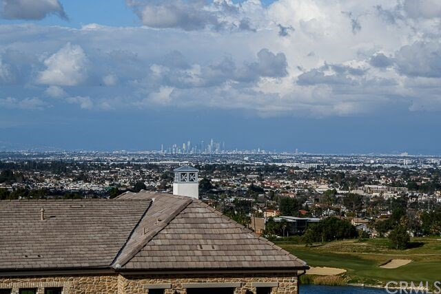 View of Downtown L.A. & private golf course from the backyard of this home.