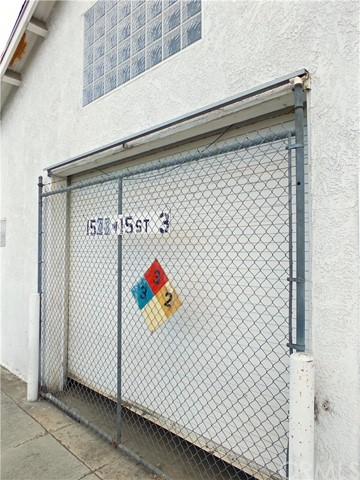 Front roll up garage door on 15th Street is one of 2 street entrances