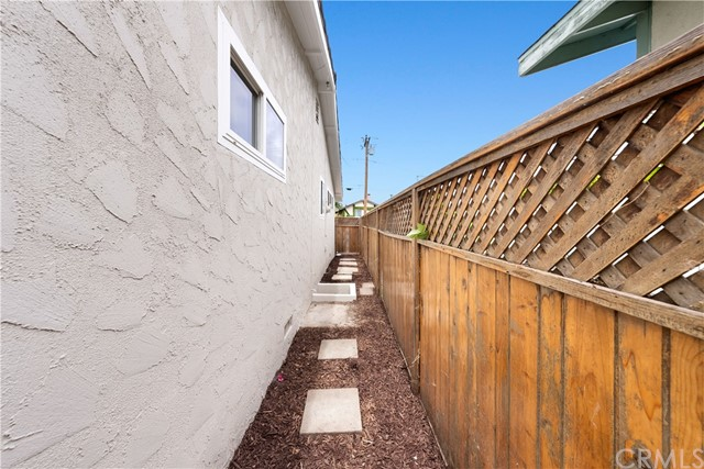 Fenced Side Yard with Crawlspace Access