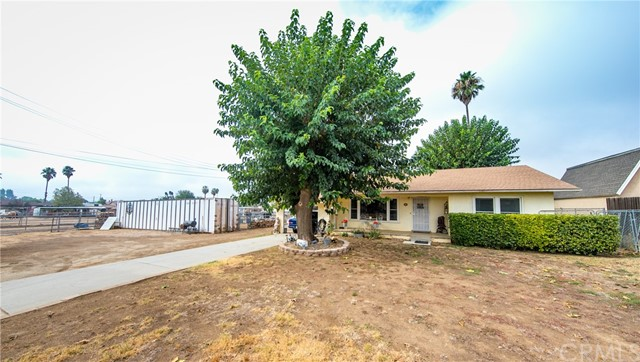 Are you a horse lover? This ranch sits on a little over an acre and is complete with 11 stalls, an arena with solar lights, a lighted round pen, 10x10 feed room, a tack room, a chicken pen and a covered grooming area. This 2 bed room 1 bath home offers so much charm and character. Home features original wood floors and a wood burning fireplace. The detached garage has a separate living quarters off of it which was rented out. This homes has endless potential and is just waiting for your personal touch.  You are not going to want to miss this opportunity.
