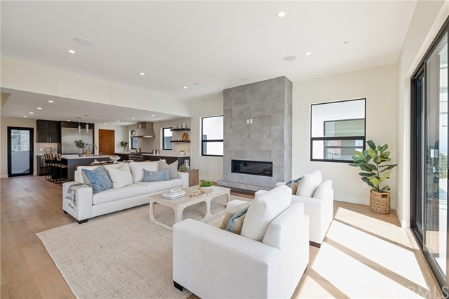 Modern architecture, high ceilings, natural light and an open floor plan (shown here using reverse of 961 Unit A staging)