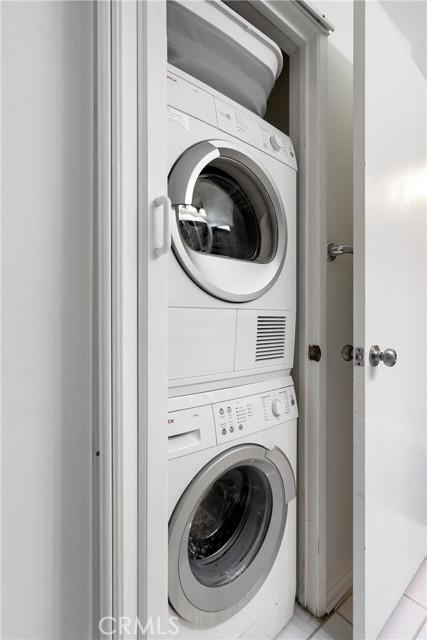 Washing machine and driver with accordion door