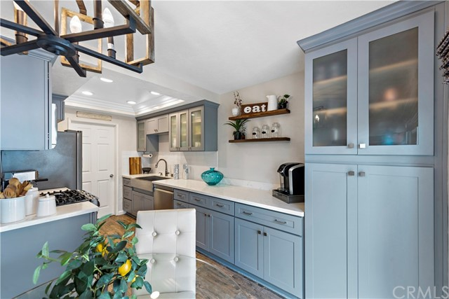 Spectacular custom kitchen has been extended to accommodate ample storage space.